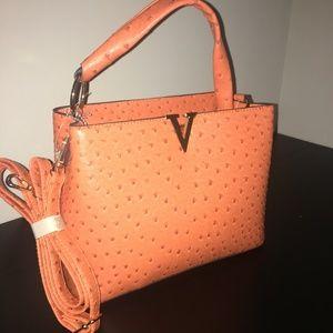 Vegan Ostrish leather bag.